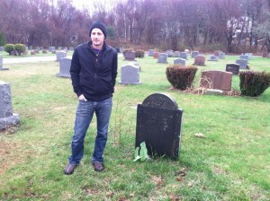 Me, standing by the tombstone